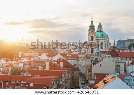 Top view of a beautiful city with an ancient church. Toned - stock photo