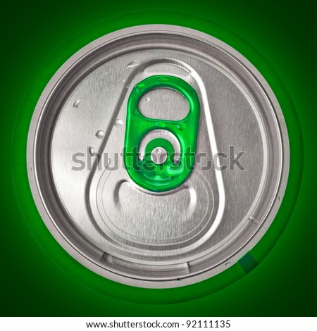 Top view of a beer or soft drink can on a green background - stock photo