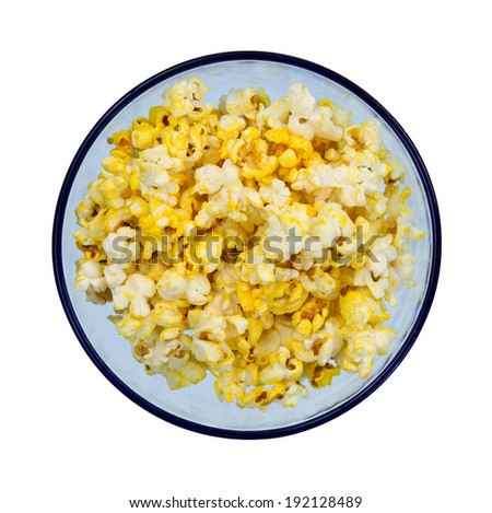 Top view of a blue bowl with buttered popcorn on a white background. - stock photo