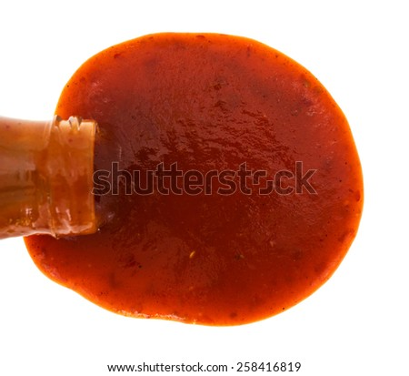 Top view of a bottle of taco sauce on its side spilling onto a white background. - stock photo