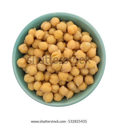 Top view of a bowl filled with organic garbanzo beans isolated on a white background.