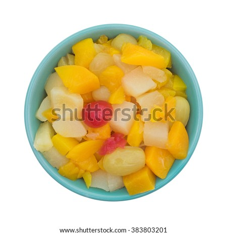 Top view of a bowl of canned fruit cocktail in a bowl isolated on a white background. - stock photo