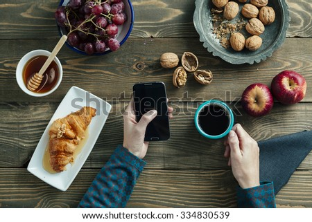 top view of a breakfast table and hands of a woman - stock photo
