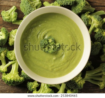 Top view of a broccoli soup in a white bowl  - stock photo
