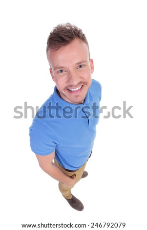 top view of a casual young man holding his hand in his pocket and smiling for the camera. on a white background - stock photo