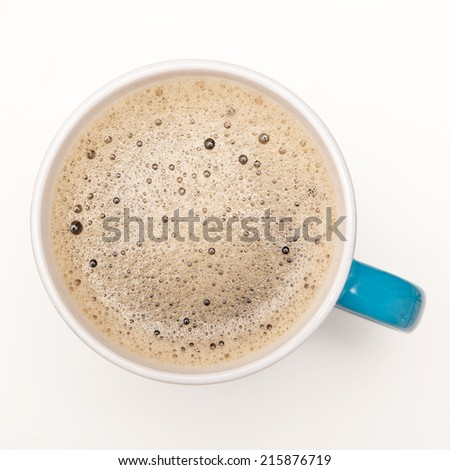 Top view of a coffee cup with gentle foam - stock photo