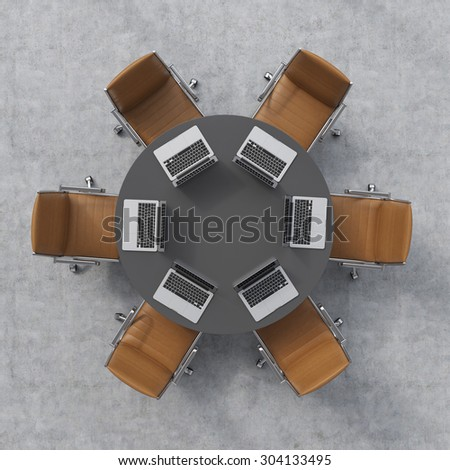 Top view of a conference room. A black round table, six brown leather chairs and six laptops. Office interior. 3D rendering. - stock photo