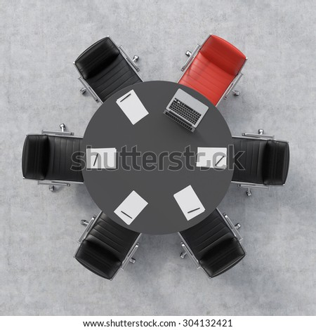 Top view of a conference room. A black round table, six chairs, one of them is red. A laptop and five papers. Office interior. 3D rendering. - stock photo