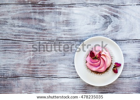 Top view of a creamy cupcake