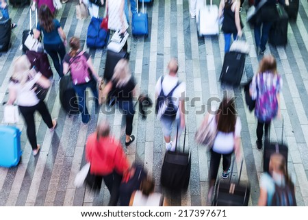 top view of a crowd of commuters in motion blur
