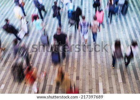 top view of a crowd of commuters in motion blur - stock photo