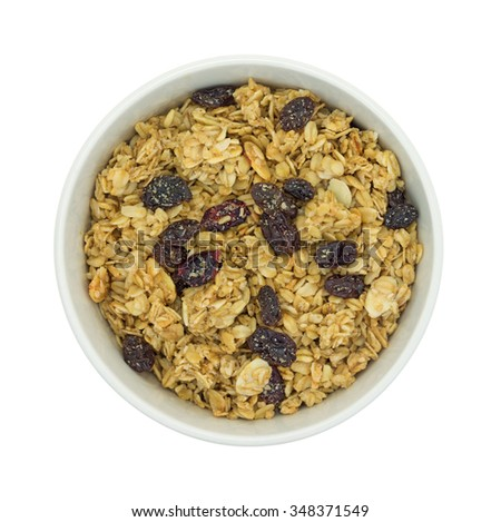 Top view of a dry mix of fruit and assorted nuts granola cereal in a bowl isolated on a white background. - stock photo