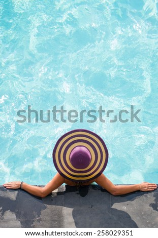 Top view of a  girl in the swimming pool - stock photo