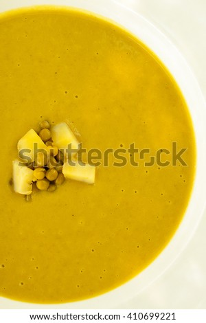 Top view of a green pea soup - stock photo