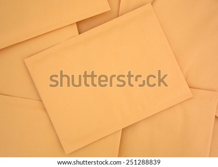 Top view of a group of blank manila padded mailing envelopes with the center at an angle. - stock photo