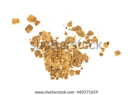 Top view of a group of broken chocolate chip animal crackers on a white background.