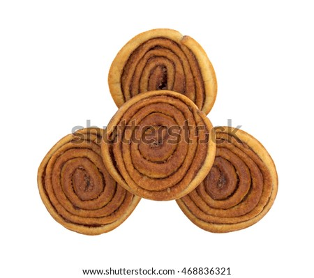 Top view of a group of pecan sweet rolls isolated on a white background.