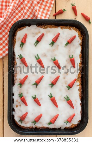 Top view of a homemade carrot cake with handmade marzipan carrots - stock photo