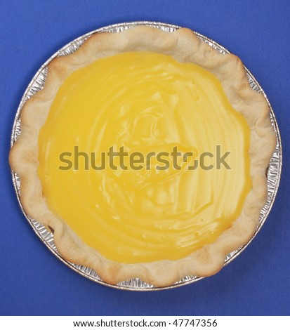 top view of a homemade lemon pie, blue background - stock photo