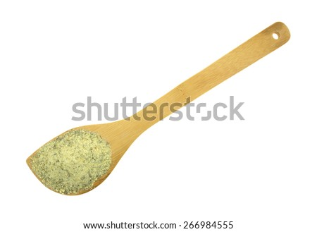 Top view of a large wood spoon with a portion of dry balsamic vinegar dressing mix ingredients on a white background. - stock photo