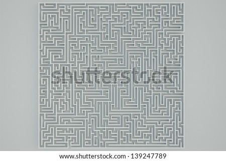 Top view of a maze on a white background. - stock photo