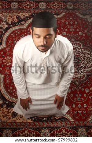 Top view of a Muslim praying process - stock photo