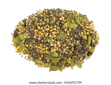 Top view of a portion of chia, cranberry and pumpkin seeds breakfast cereal isolated on a white background. - stock photo