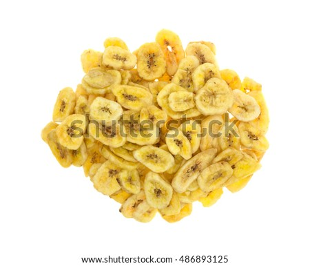 Top view of a portion of dehydrated banana chips isolated on a white background.