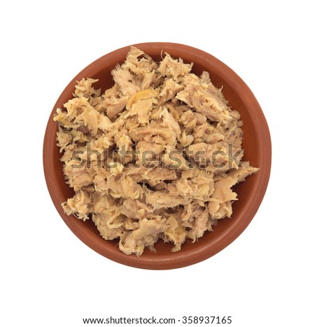 Top view of a portion of lemon pepper flavored tuna in a small bowl isolated on a white background. - stock photo