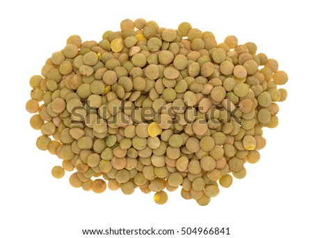 Top view of a portion of organic green lentils isolated on a white background.