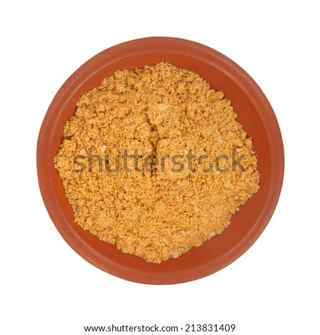 Top view of a portion of the seasonings used for making tacos in a small red bowl atop a white background. - stock photo
