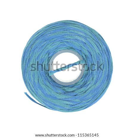 Top view of a roll of new mint flavored dental floss on a white background.
