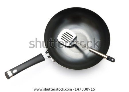 top view of a saucepan and spatula on white - stock photo