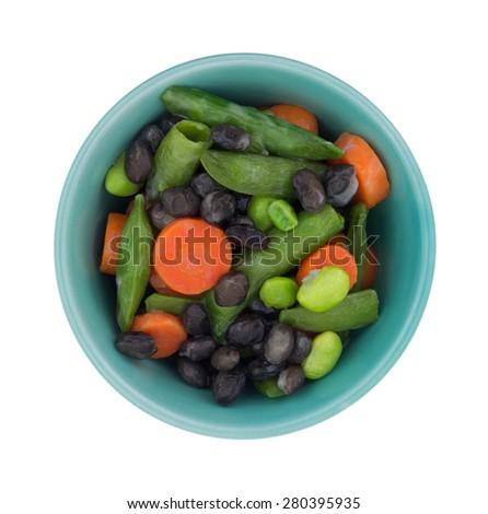 Top view of a small bowl of buttered vegetables on a white background. - stock photo