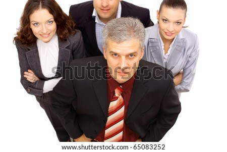 Top view of a smiling group of business people standing together and looking up