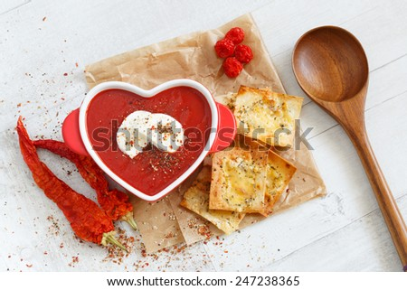 top view of a spicy tomato soup with mozzarella and chips - stock photo