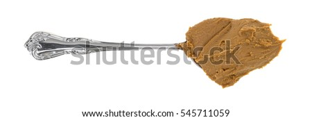 Top view of a spoonful of cookie butter isolated on a white background.