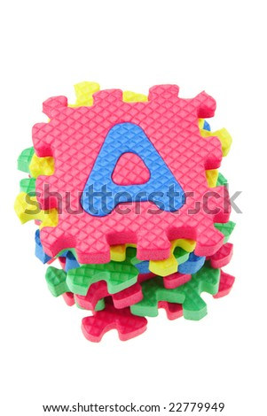 Top view of a stack of alphabet puzzle blocks on white background - stock photo