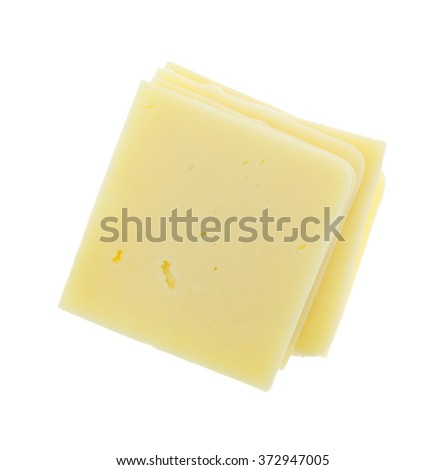 Top view of a stack of square cheddar cheese slices isolated on a white background. - stock photo