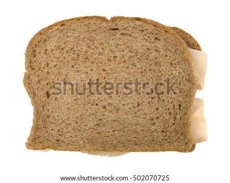 Top view of a turkey breast with mayonnaise sandwich on wheat bread isolated on a white background.