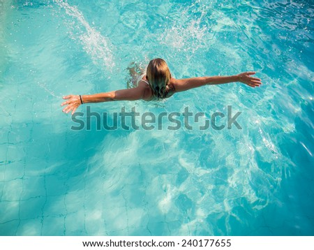 Top view of a woman in bikini at the swimming pool - stock photo