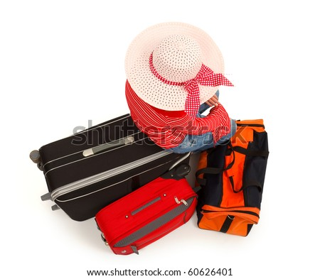 Top view of a young girl sitting on luggage and waiting. Isolated on white - stock photo