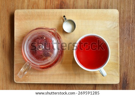 Top view of an isolated cup of  hibiscus tea        - stock photo