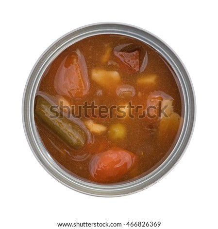 Top view of an opened can of beef stew on a white background.