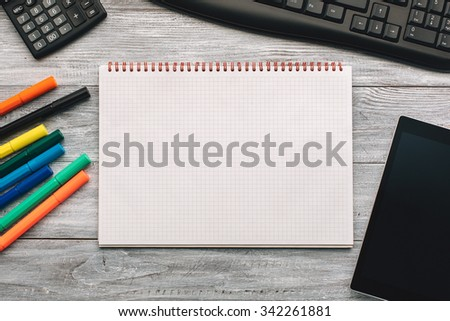 Top view of an opened notebook on a wooden desk.  - stock photo