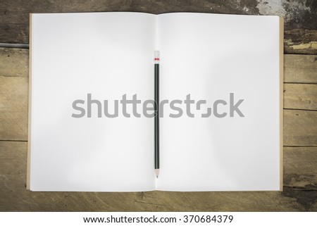 Top view of an opened notebook on a wooden desk,pen book with blank pages on wood table-can be used for montage or display your products - stock photo