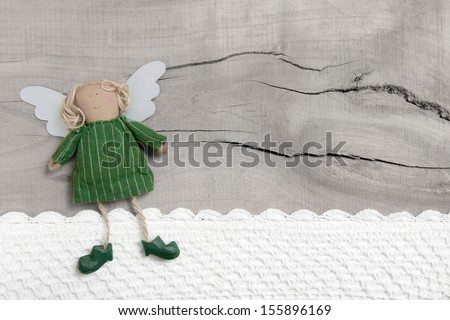 Top view of an shabby chic angel with crochet strip on wooden background for christmas - stock photo