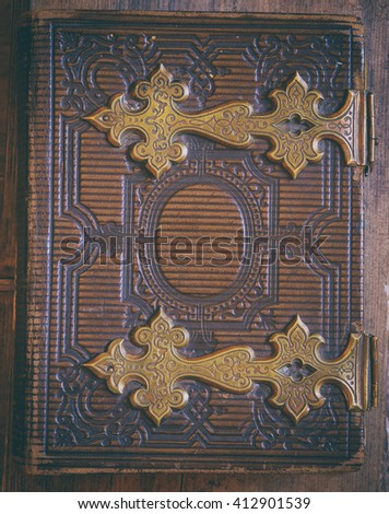 top view of antique book cover, with brass clasps. vintage filtered and toned - stock photo