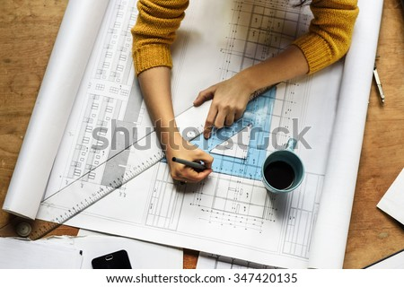 Top view of architect drawing on architectural project - stock photo
