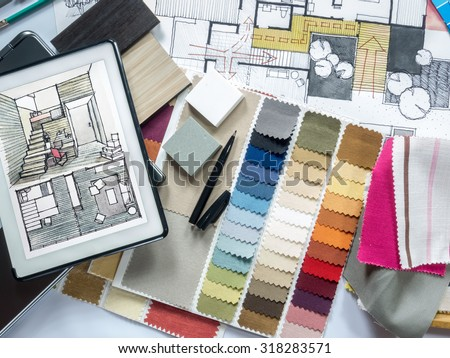 Top view of Architect & Interior designer working table with equipment and material sample/ home renovation concept - stock photo